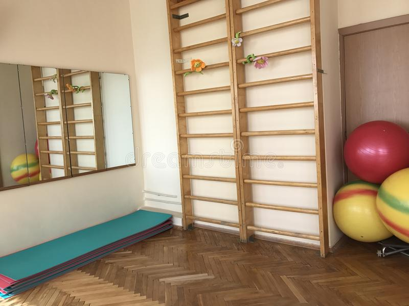The program of medical rehabilitation. The room of physiotherapy exercises. stock photo