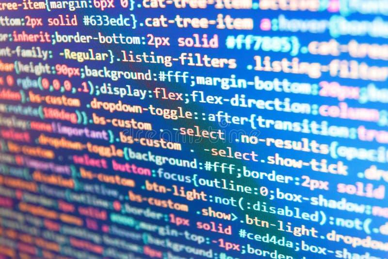 Programação da Web e fundo da tecnologia do suporte Códigos do site na língua e em codificar do PHP do monitor do computador o co imagens de stock