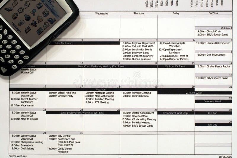 Programma di lavoro mensile & PDA immagine stock