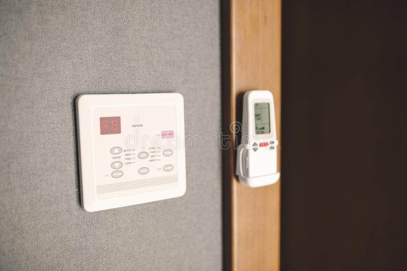 Programmable thermostat in room stock images