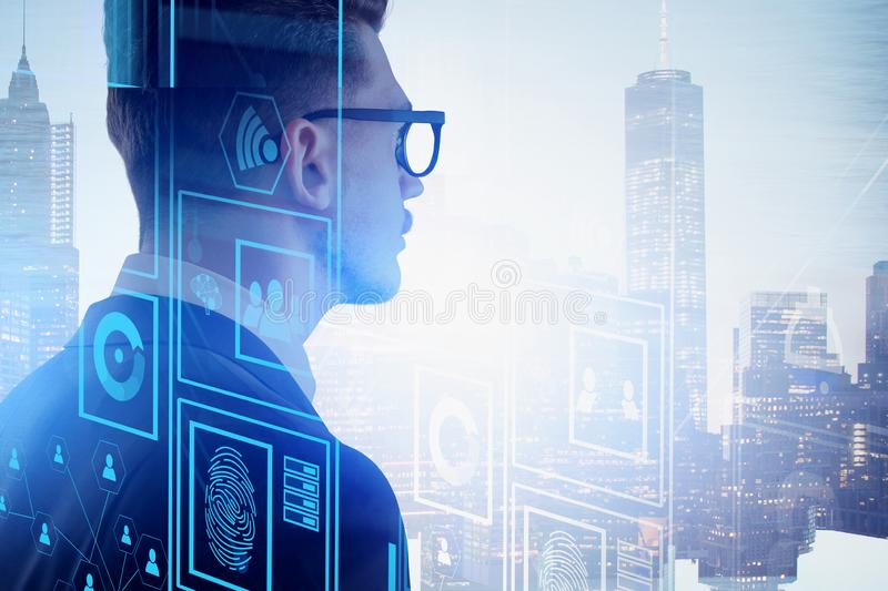 Programmer in city, online security concept. Rear view of businessman in glasses looking at city. Double exposure of online security interface. Smart city stock photo