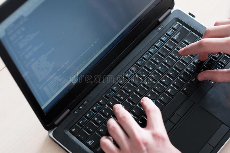 Programmer courses typing code laptop software royalty free stock images