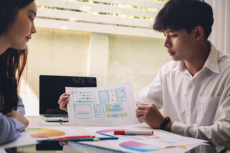 Programmer engineers discussion and drawing website ux app for start new project web design in company office. Developing stock images