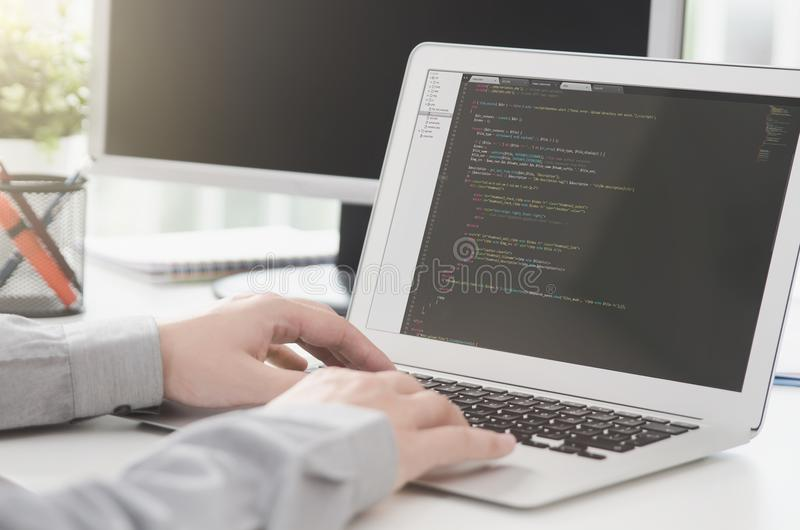 Programmer working busy software developing in company office royalty free stock photos