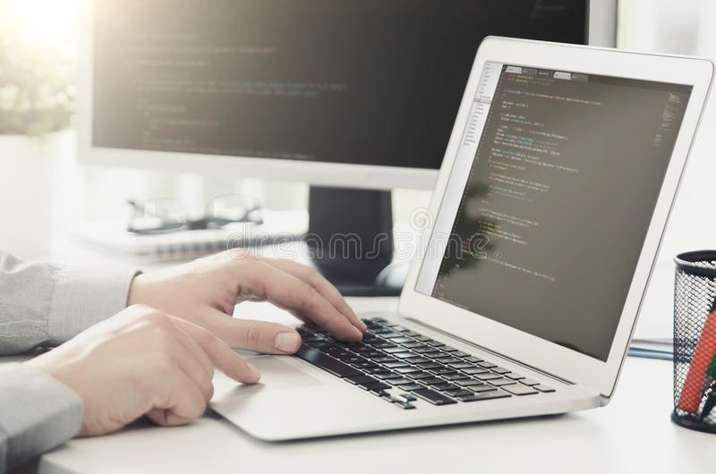 Programmer working busy software developing in company office royalty free stock photo