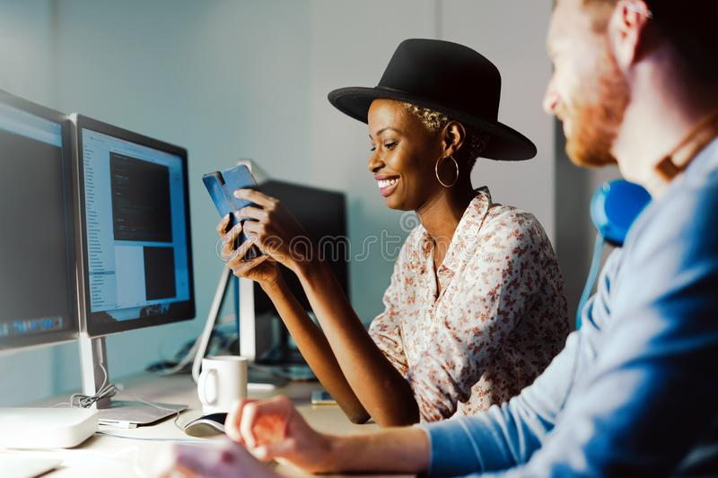 Programmers cooperating at information technology company stock image