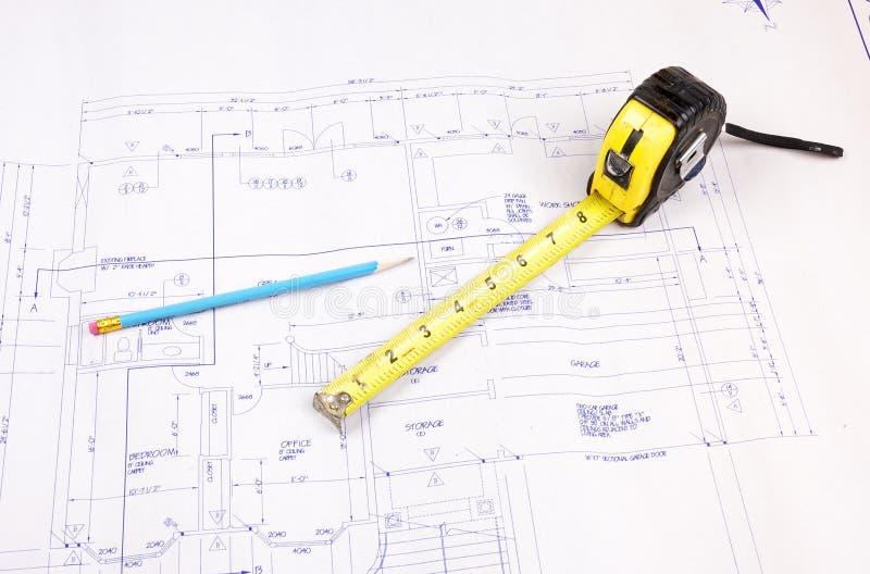Programmi della costruzione e misura di nastro fotografia stock libera da diritti