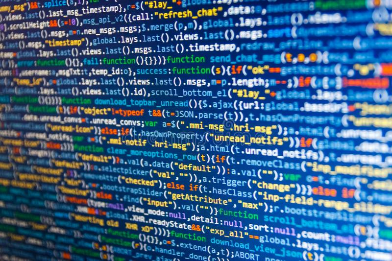 Programming code. Website design. Freeware open source project. Developer working on websites codes in office royalty free stock photo