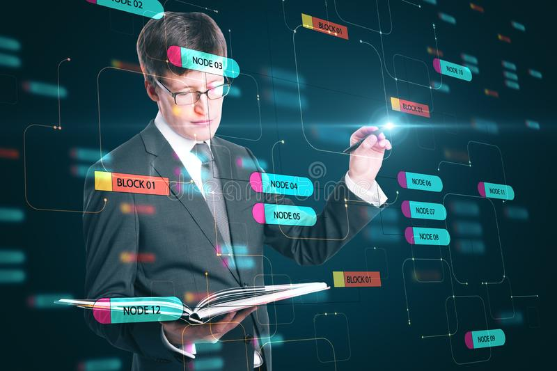 Programming concept with businessman looking in a book and touching digital screen with node tree stock photography