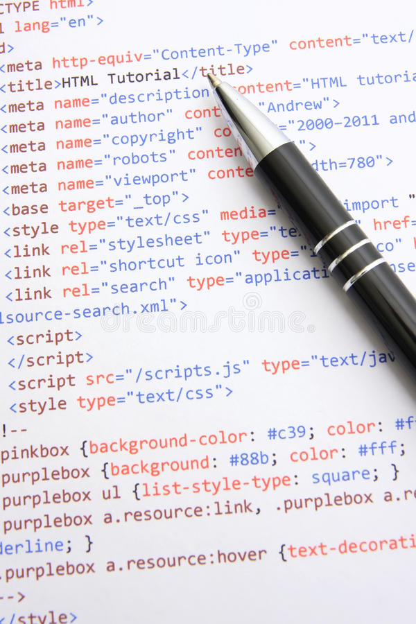 Programming HTML. A sheet of paper with html source code and pen lying on it stock images