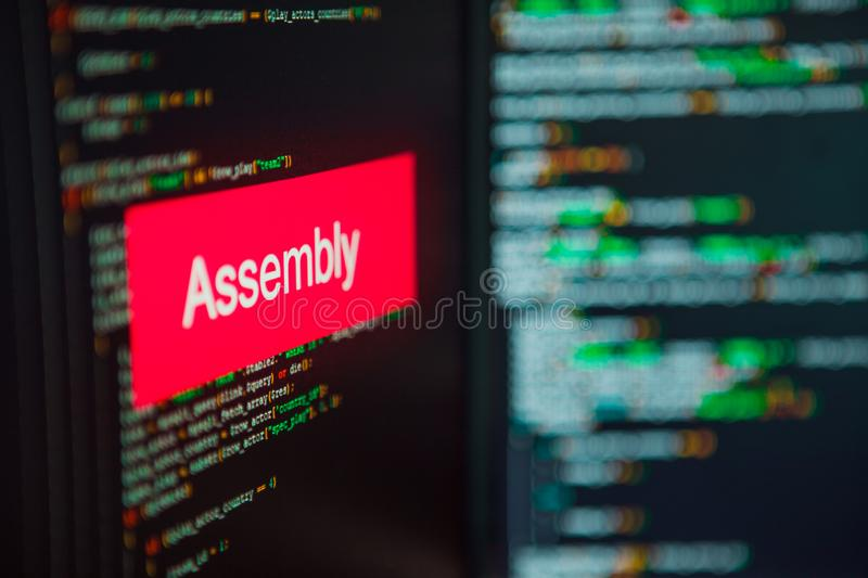 Programming language, Assembly inscription on the background of computer code. stock photos