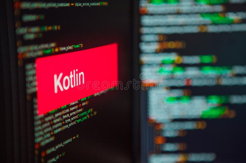 Programming language, Kotlin inscription on the background of computer code. stock images
