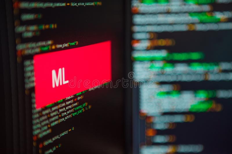 Programming language, ML inscription on the background of computer code. stock image