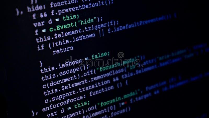 Programming script application code running down a computer screen stock photos