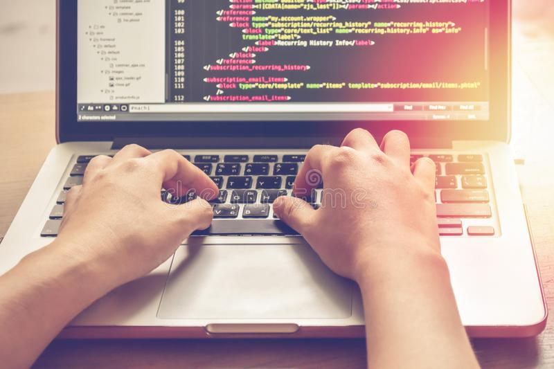 Programming Work Time. Programmer Typing New Lines of HTML Code. Laptop and Hand Closeup. Working Time. Web Design Business Concept stock photos