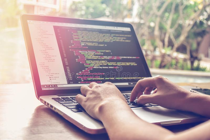 Programming Work Time. Programmer Typing New Lines of HTML Code. Laptop and Hand Closeup. stock photography