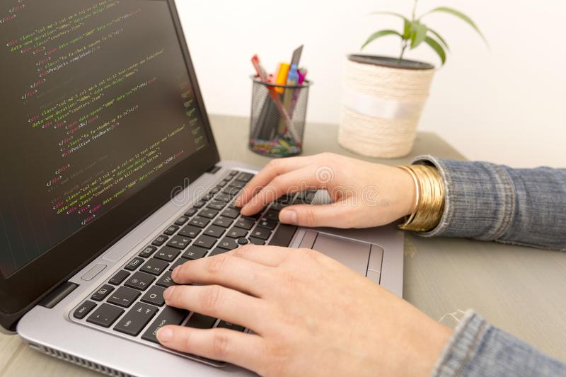Programming Work Time. Programmer Typing New Lines of HTML Code. royalty free stock images