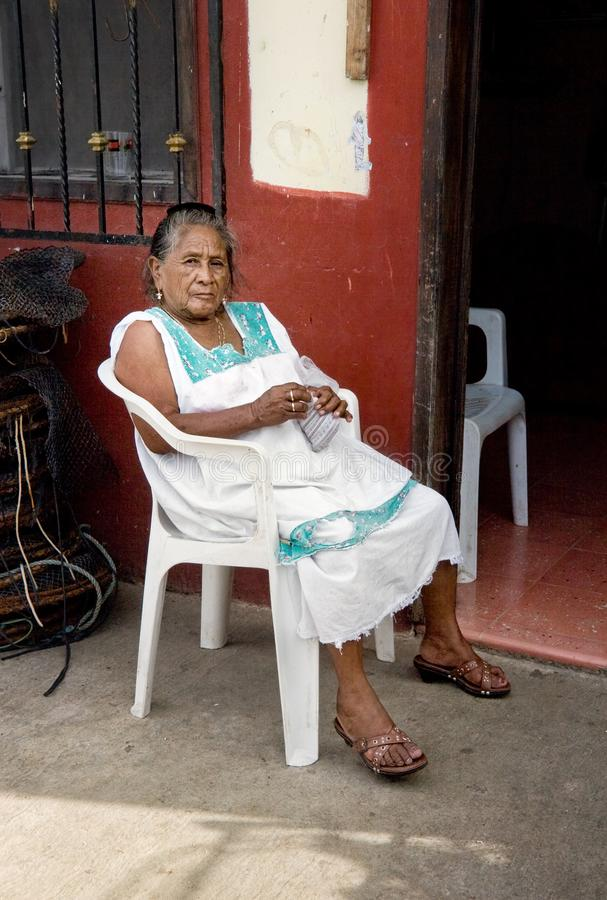 Progreso, Mexico - October 14, 2007: Poor old woman sitting in p royalty free stock images