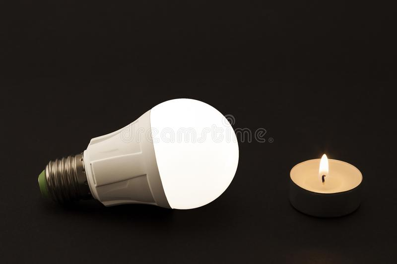 Progress of lighting with candle and LED bulb. royalty free stock photos