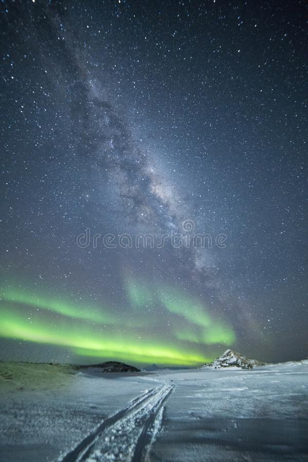 Northern Lights and the Milky Way in the starry sky. View of Antarctica. Night. stock photography