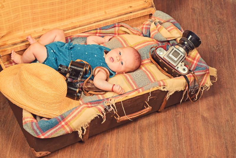 Progressive baby. Family. Child care. Small girl in suitcase. Traveling and adventure. Portrait of happy little child stock image
