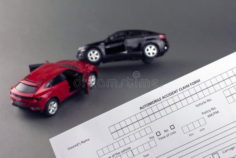 Progressive car insurance. Car crash scene two broken cars and car insurance document. progressive car insurance concept. gray background stock photo