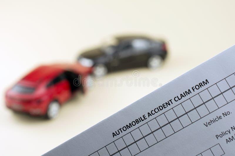 Progressive car insurance concept. Car crash scene two broken cars and car insurance document,  progressive car insurance concept. yellow background royalty free stock photo