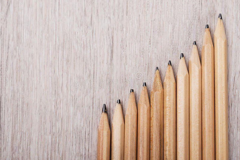 Progressive Graph Made From Pencils. On wooden table stock photos