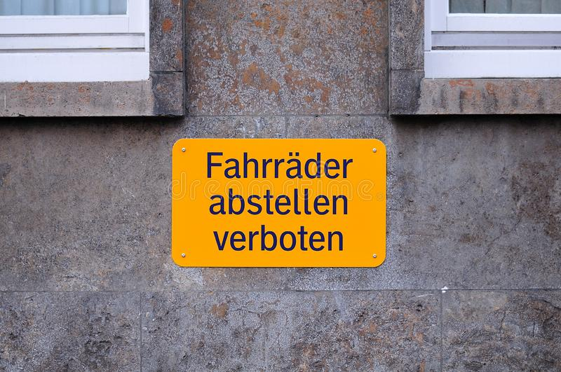 Prohibition sign in german language: parking of bicycles forbidden. Yellow prohibition sign at a facade with german inscription: parking of bicycles is forbidden royalty free stock photos
