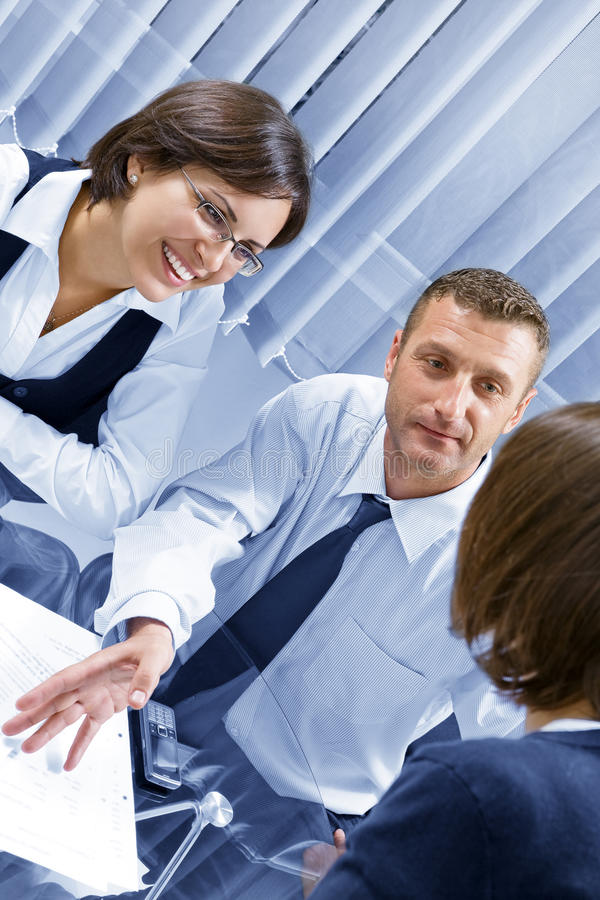 Project. Portrait of young business people discussing project in office environment stock photo