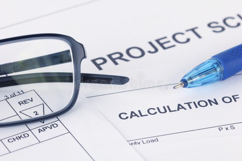 Project Calculation document with pen and eyeglasses stock photos
