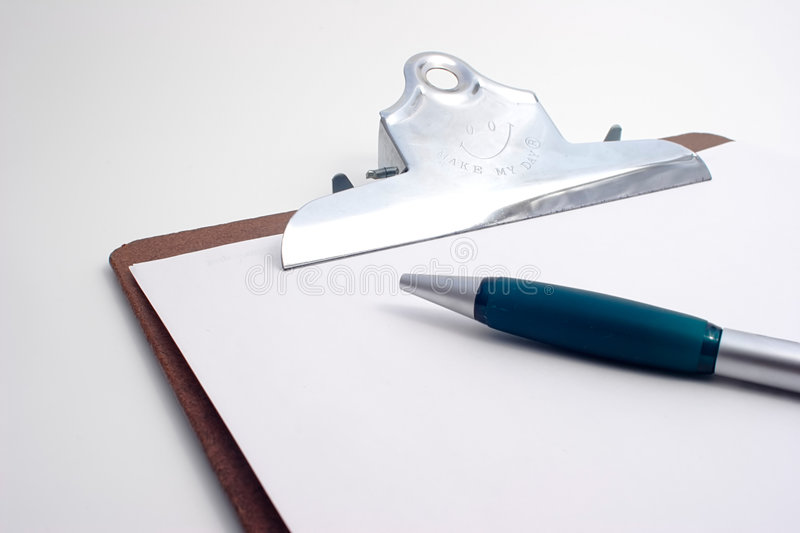 Project Clipboard with pen stock photography