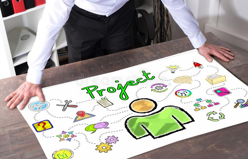 Project concept on a desk. Man watching a project concept placed on a desk royalty free stock photos