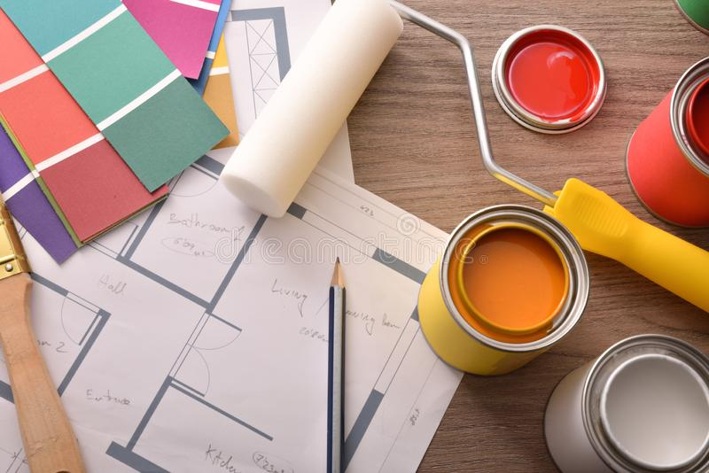 Project home decoration with open paint cans and tools stock photography