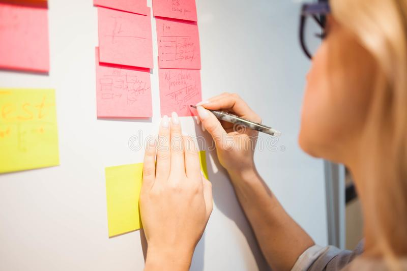 Project management, agile methodology. young business woman in the office are working on a startup. Project manager plan work and stages of development of stock photography