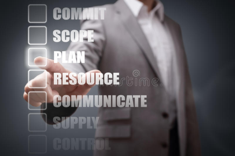 Project Management. Businessman selecting project management stage options for planning and strategy stock photo