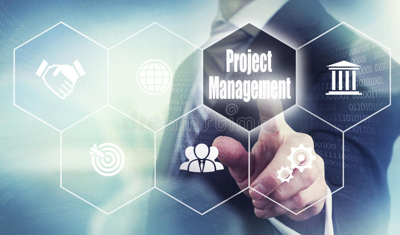 Project Management Concept. A businessman pressing a Project Management button on a transparent screen royalty free stock photos
