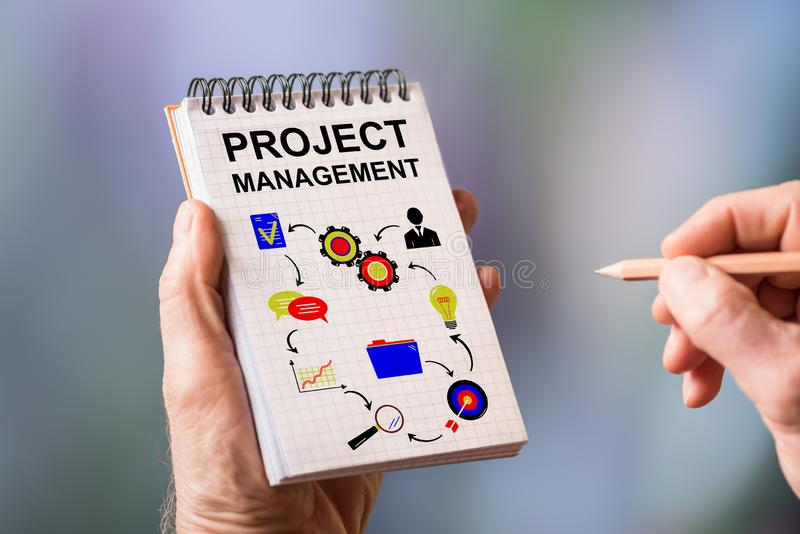 Project management concept on a notepad. Hand drawing project management concept on a notepad royalty free stock image
