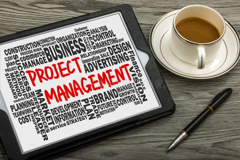 Project management concept with related word cloud. Handwritten on tablet pc stock images