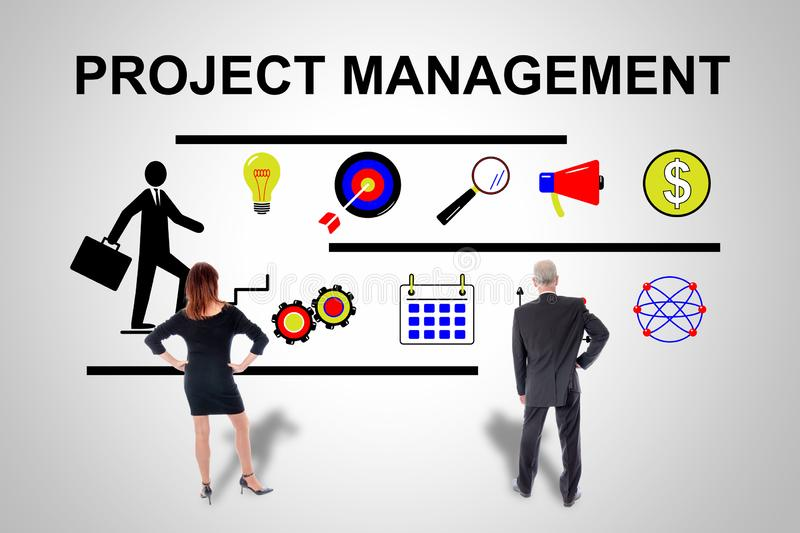 Project management concept watched by business people. Project management concept drawn on a wall watched by business people royalty free stock photos