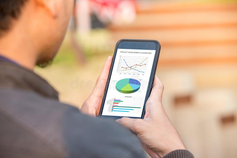 Project management dashboard concept on phone screen royalty free stock image