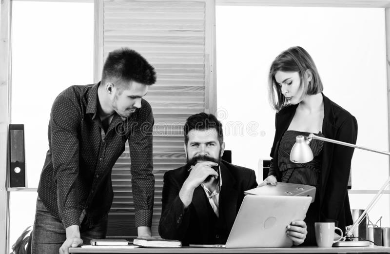 Project management team. Business team working and communicating together at office desk. Professional team at work stock photography