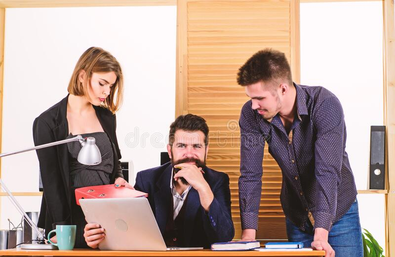 Project management team. Business team working and communicating together at office desk. Professional team at work royalty free stock photos