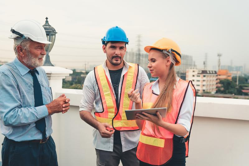 Project management team of engineers and architects discussing a stock photography
