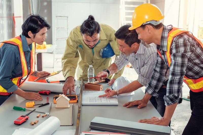 Project management team of engineers and architects planing brainstorming for new project, Business construction concepts royalty free stock photography