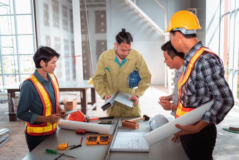 Project management team of engineers and architects planing brainstorming for new project., Business construction concept royalty free stock image
