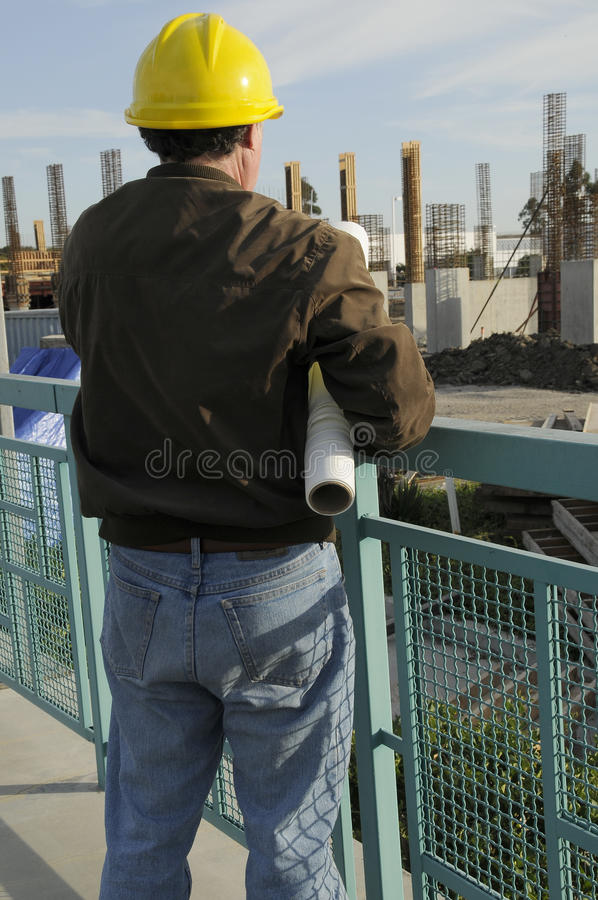 Project Manager. Man checking on current construction project stock images