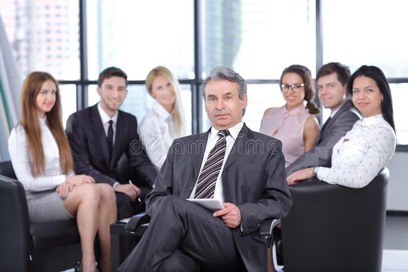 Project Manager against the background of the business team. The concept of teamwork stock photos
