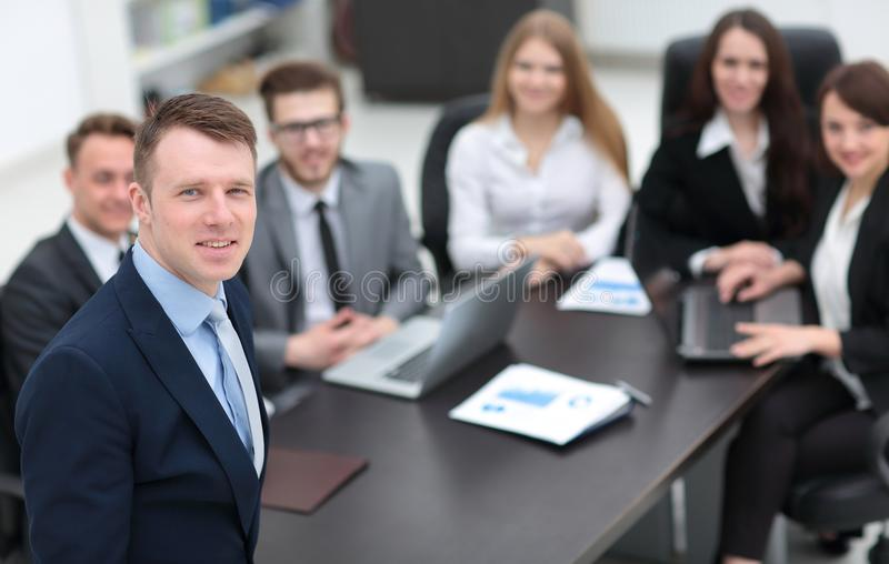 Project Manager on the background of business team. Young businessman on the background of business team royalty free stock photos