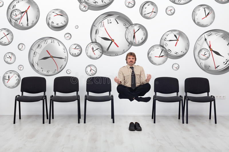 Project manager bending time to meet deadlines. Project manager juggling with deadlines - surrounded by distorted wall clock bubbles stock images
